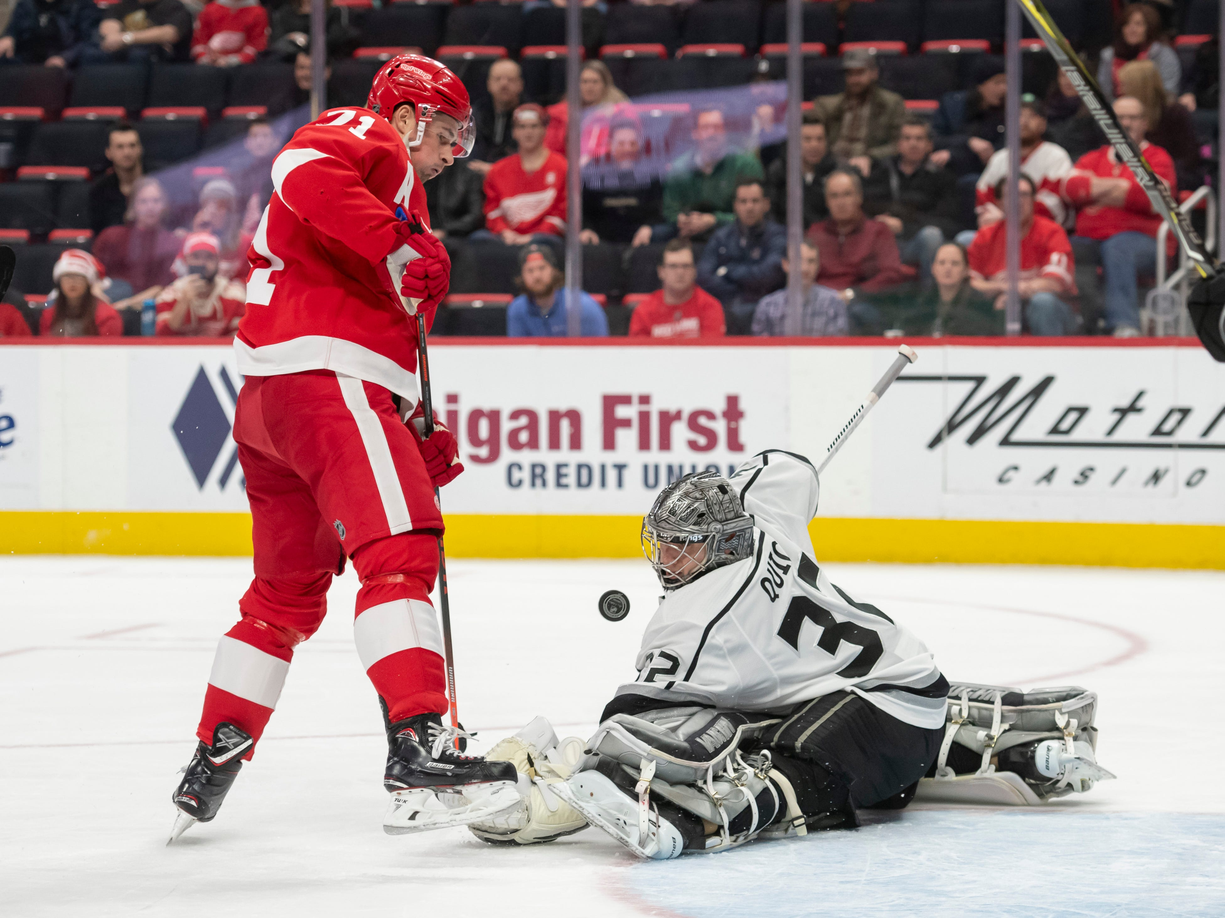Detroit center Dylan Larkin gets a shot blocked by Los Angeles goaltender Jonathan Quick in the third period.