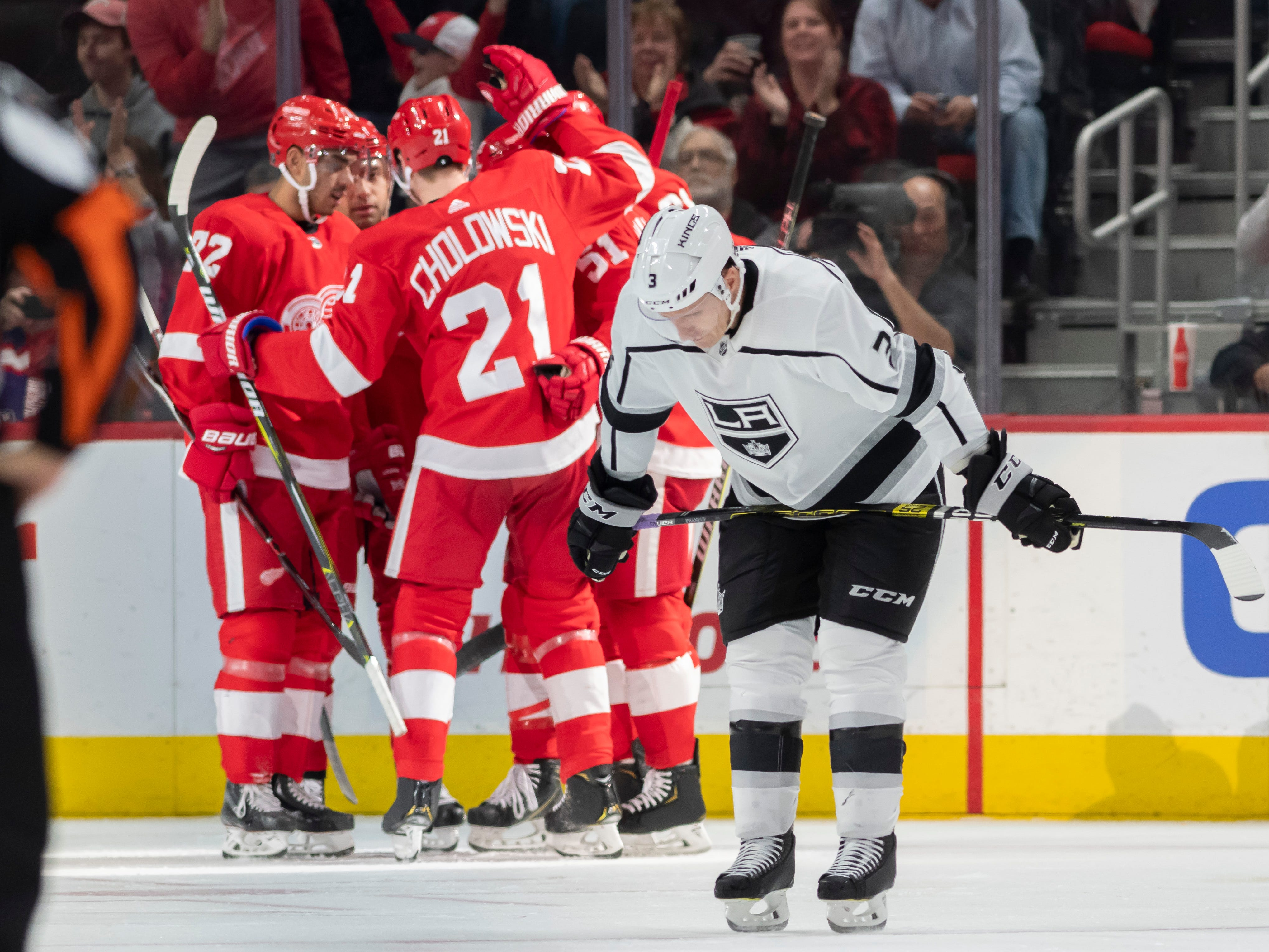 Los Angeles defenseman Dion Phaneuf looks away as Detroit celebrates a goal by center Frans Nielsen in the second period.