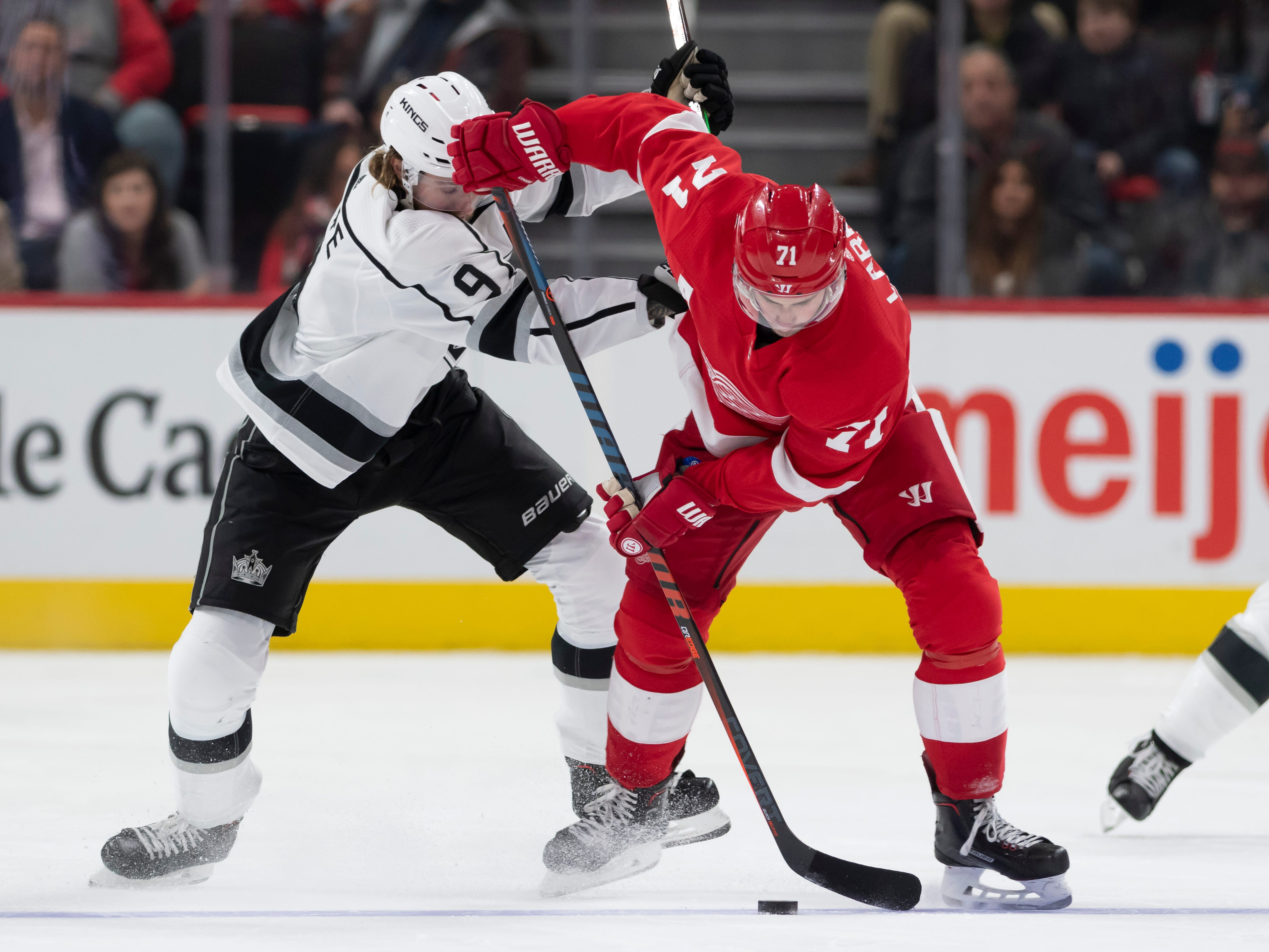 Detroit center Dylan Larkin and Los Angeles right wing Adrian Kempe battle for the puck in the second period.