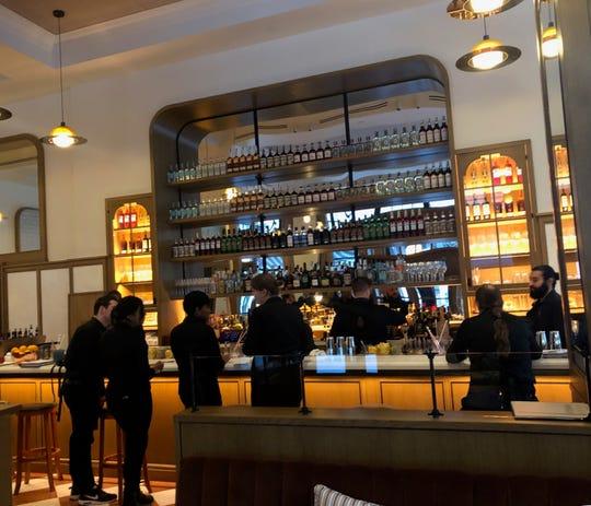Servers gather around the bar at San Morello while training on Tuesday.