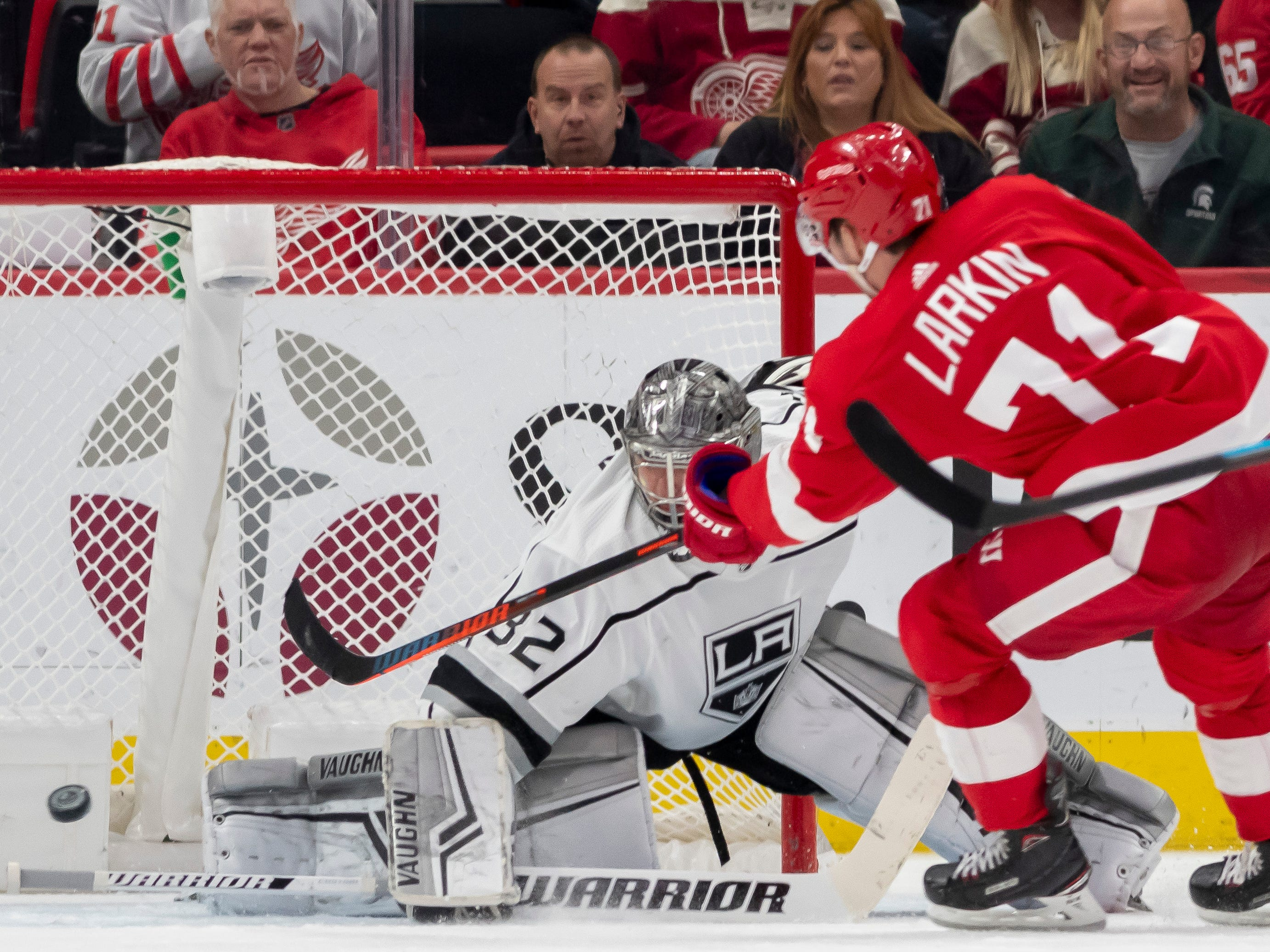 Detroit center Dylan Larkin sends the puck past Los Angeles goaltender Jonathan Quick for a goal in the second period.