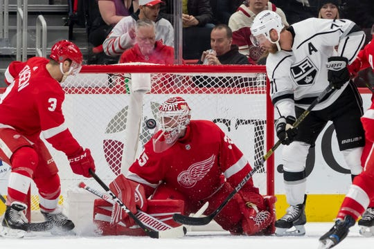 Los Angeles center Jeff Carter can't get the puck past Detroit defenseman Nick Jensen and goaltender Jimmy Howard late in the third period. Howard stopped 42 shots during the game.