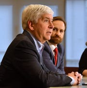 Michigan Gov. Rick Snyder and Lt. Gov. Brian Calley hold an end-of-the year roundtable with the media in the Romney Building in Lansing Tuesday.