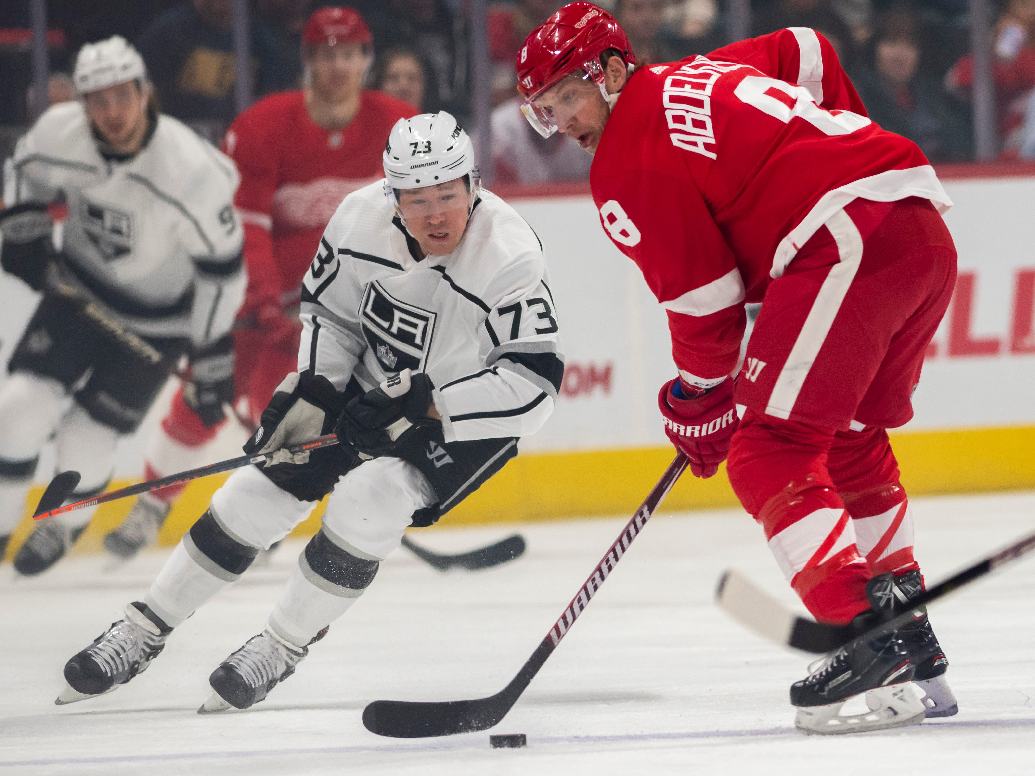 Detroit Red Wings left wing Justin Abdelkader keeps the puck away from Los Angeles Kings right wing Tyler Toffoli in the first period.