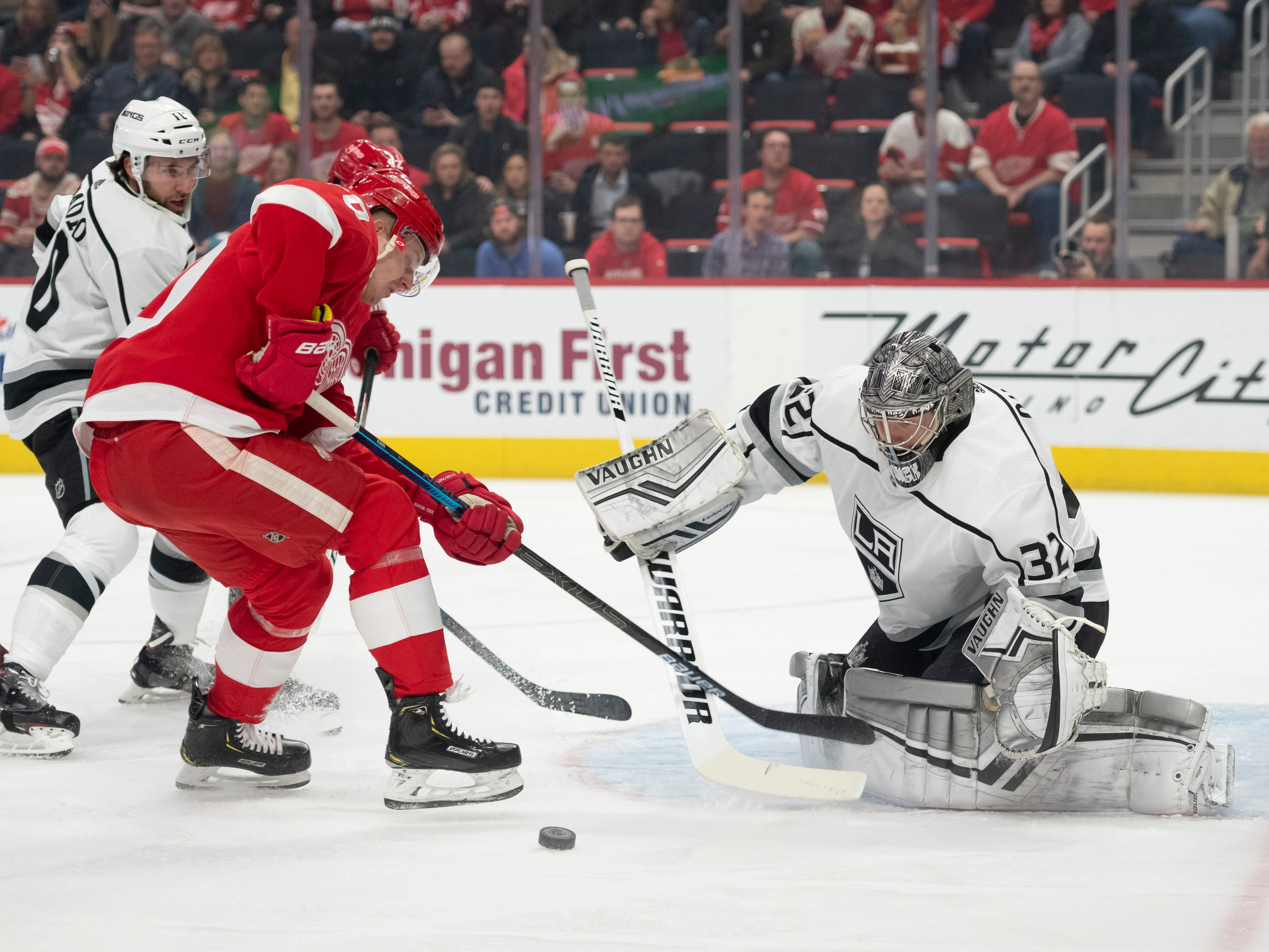 Detroit center Christoffer Ehn tries to slip the puck past Los Angeles goaltender Jonathan Quick in the first period.
