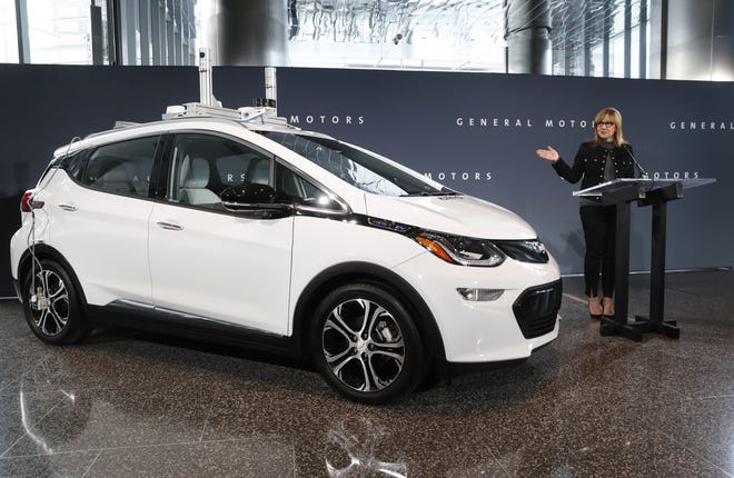 General Motors Co.'s electric Chevrolet Bolt, pictured alongside CEO Mary Barra, is expected to be the platform for the automaker's push into self-driving cars -- a transformational technology that threatens the assumptions of the traditional industry and the people who depend on it.