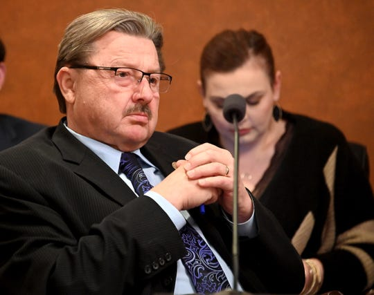 Michigan Sen. Mike Kowall, (R-White Lake) listens as Representative Rob VerHeulen (R-Walker) testifies before the Senate committee on Governmental Operations Tuesday.