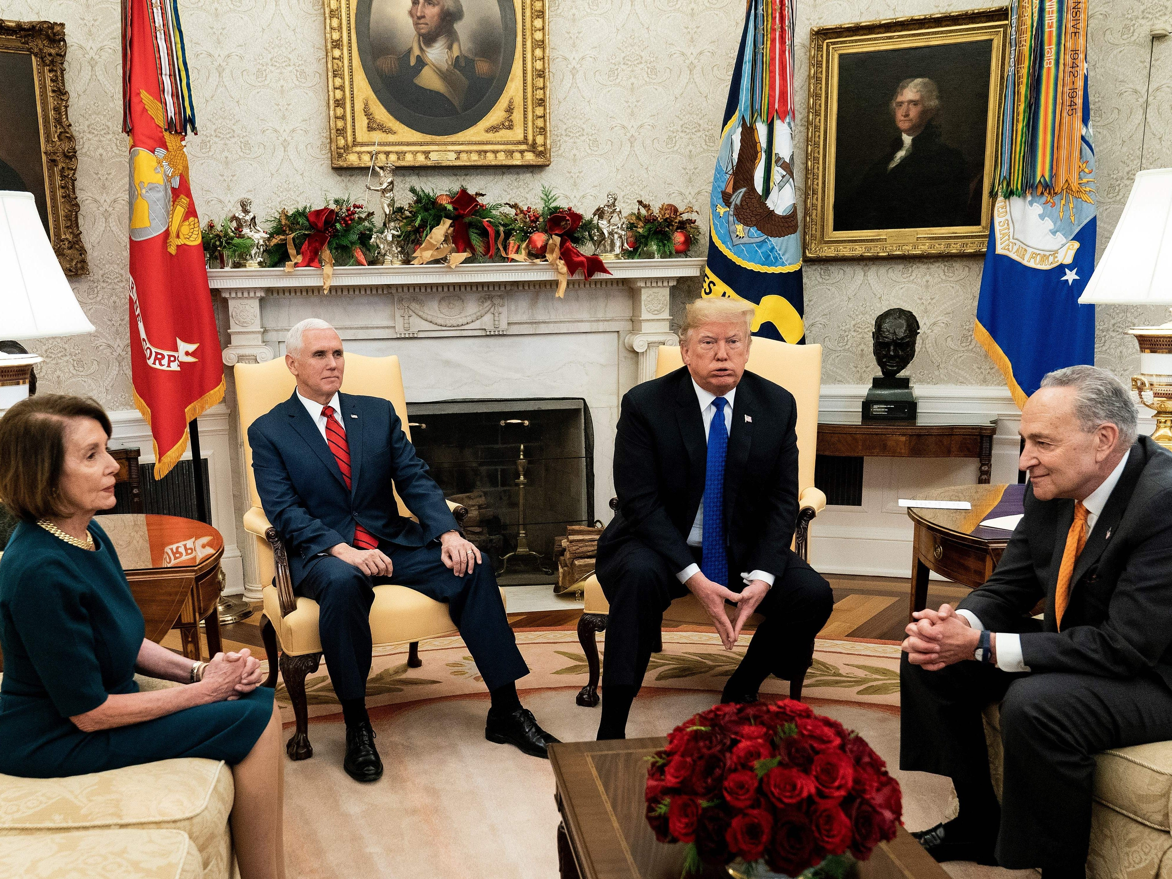 House Minority Leader Nancy Pelosi, Vice President Mike Pence, President Donald Trump, and Senate Minority Leader Charles E. Schumer wait for a meeting at the White House December 11, 2018 in Washington, D.C.