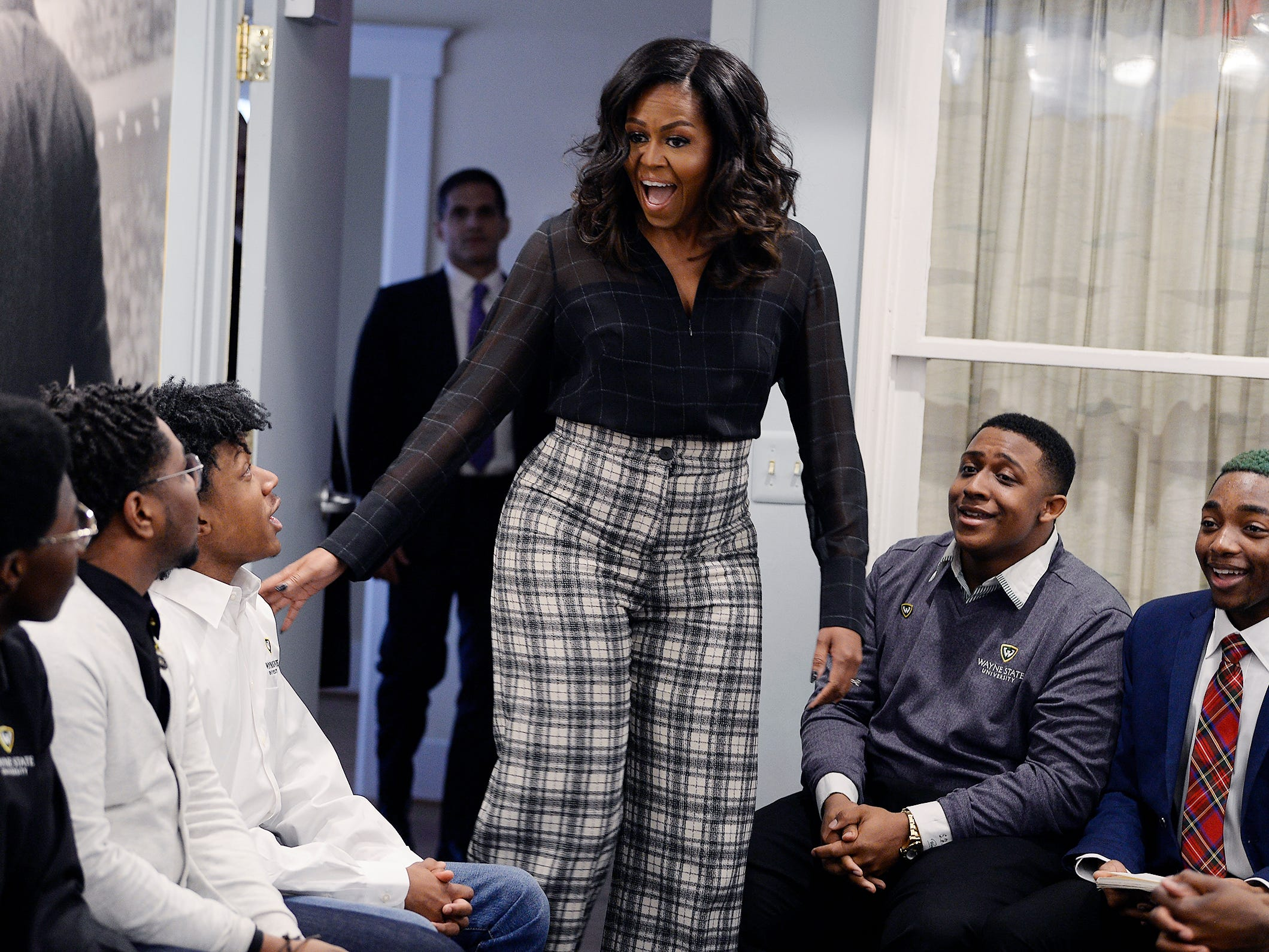 Michelle Obama makes a surprise entrance on a round table discussion with a group of men from Wayne State University during her visit at the Motown Museum., December,11, 2018, Detroit, Michigan.