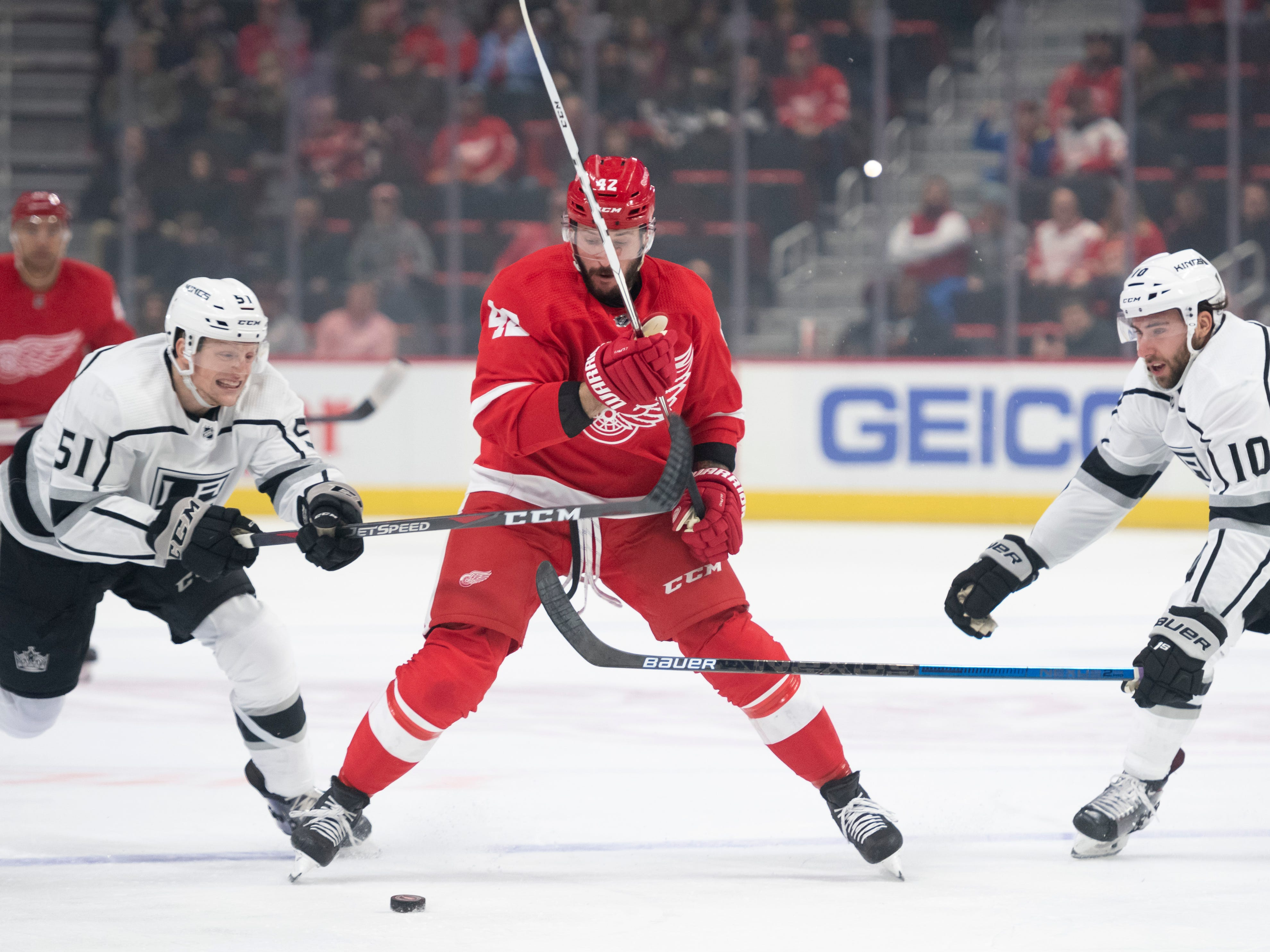 Detroit right wing Martin Frk battles for the puck with Los Angeles left wing Austin Wagner, left, and center Michael Amadio in the first period.