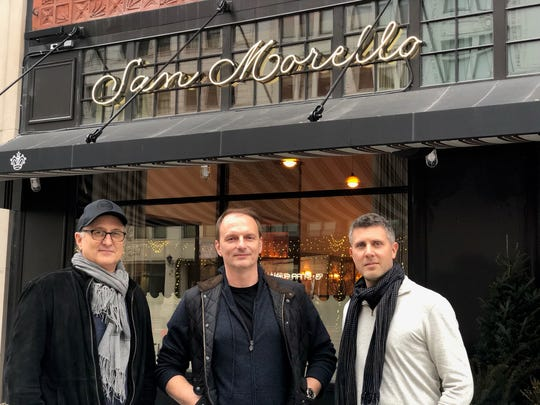 NoHo Hospitality partners Josh Pickard, left, chef Andrew Carmellini and Luke Luke Ostrom stand in front of San Morello at 1400 Woodward in Detroit