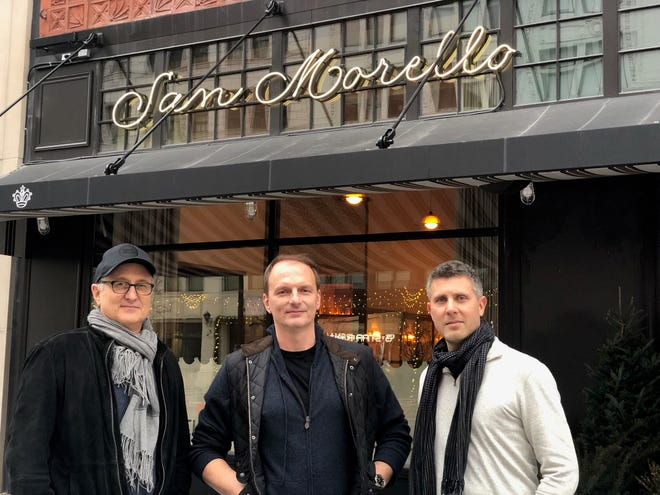 NoHo Hospitality partners Josh Pickard, left, chef Andrew Carmellini and Luke Ostrom stand in front of San Morello at 1400 Woodward in Detroit.