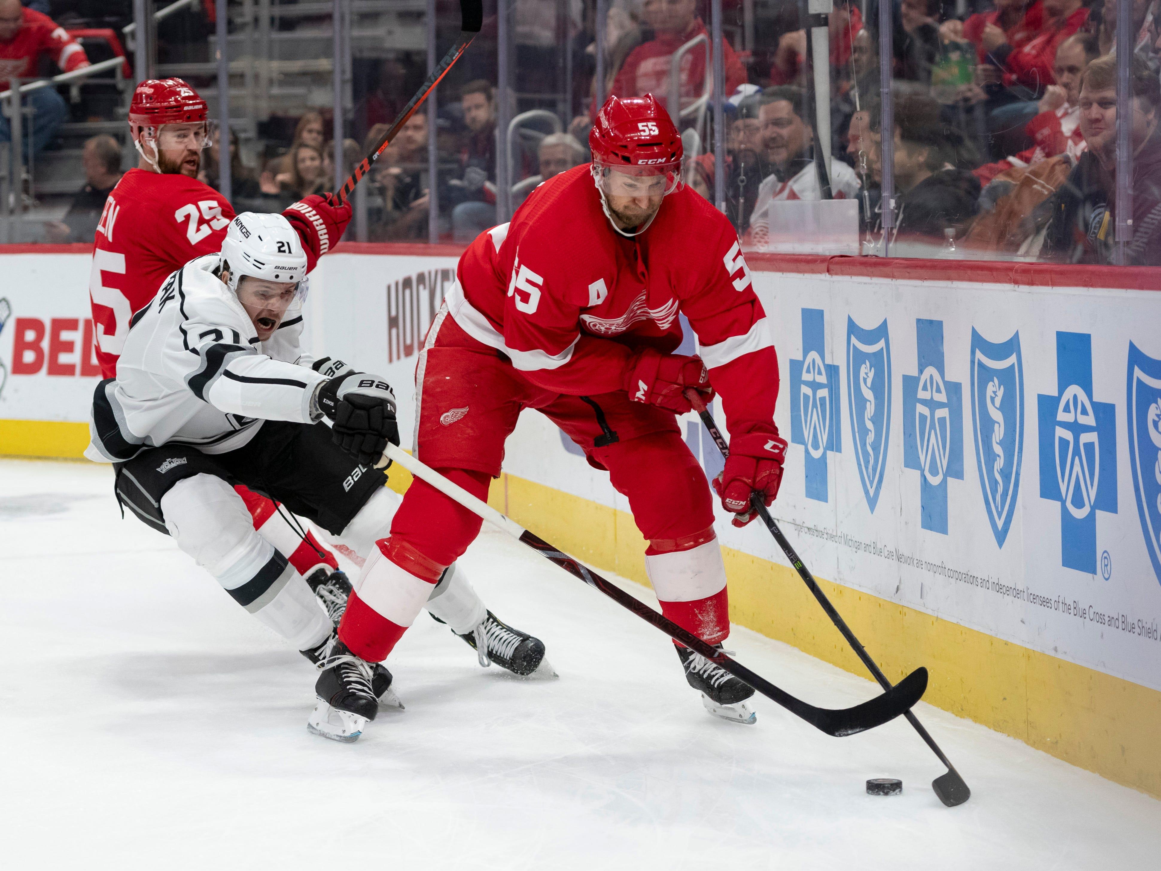 Detroit defenseman Niklas Kronwall keeps the puck away from Los Angeles left wing Nikita Scherbak in the second period.