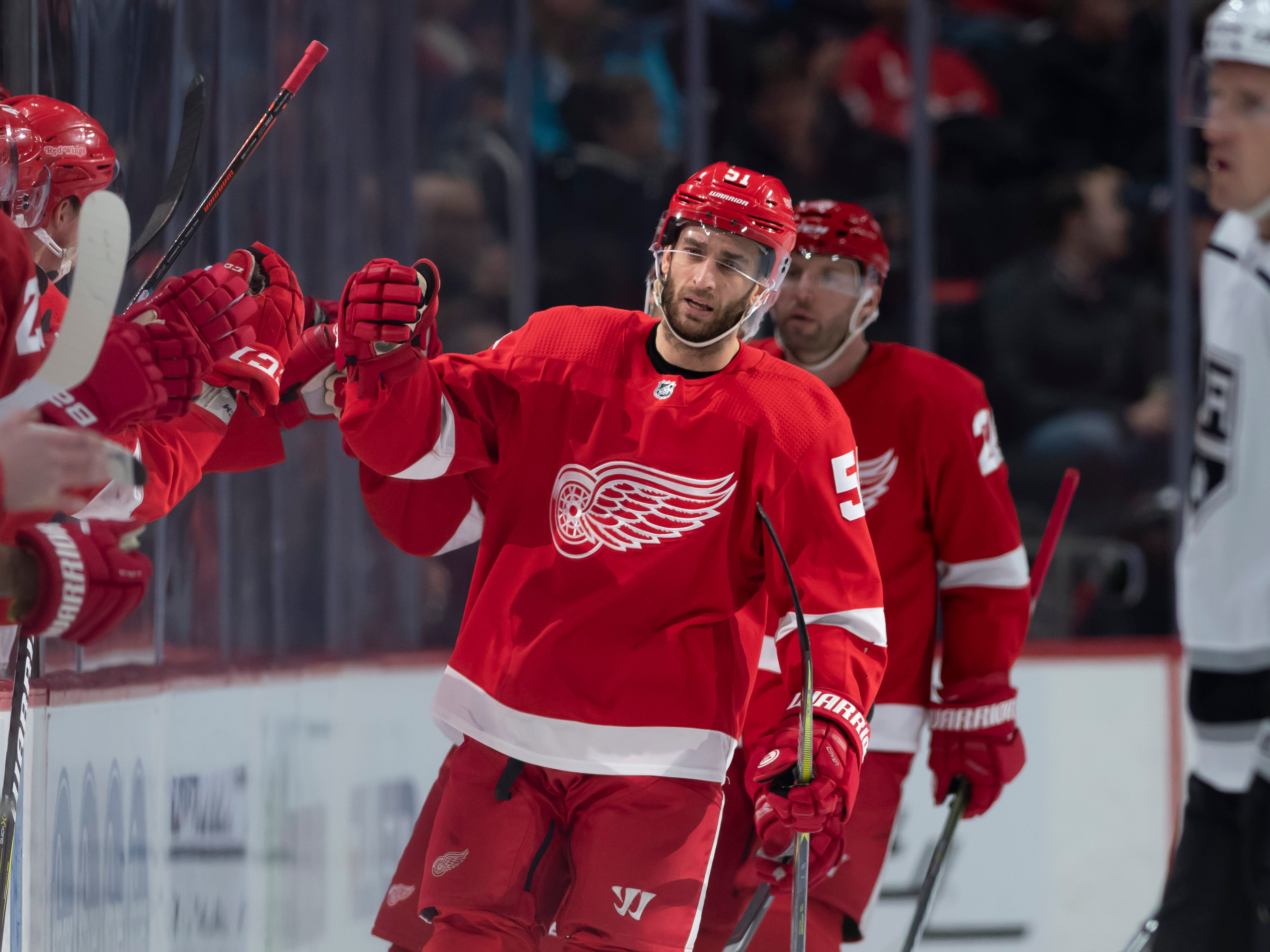 Detroit center Frans Nielsen gets high-fives from his teammates after scoring in the second period.