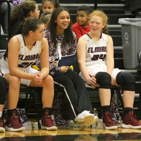 Kiara Fisher, center, watches from the bench Dec. 10, 2018 as the Elmira girls basketball team takes on Owego at Elmira High School.