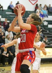 Kaci Donovan of Owego goes up for a shot against Elmira on Dec. 10, 2018 at Elmira High School.