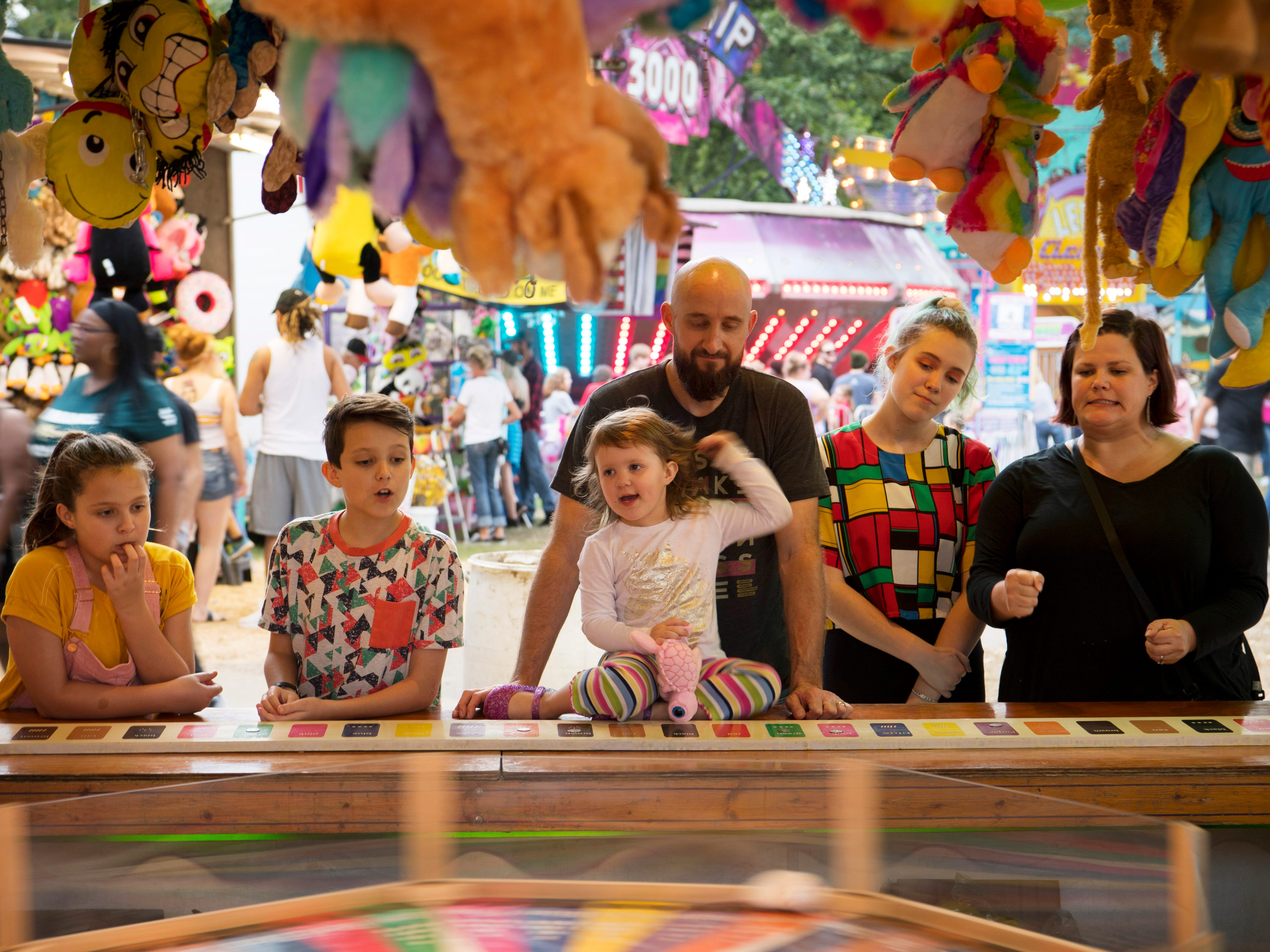 The West Side Nut Club's Fall Festival is a family tradition for Dave and Heather Harper and they made time to keep the tradition going with kids, from left, Penny, 11, Truman, 12, Jacinda, 3, and Lucy, 15.