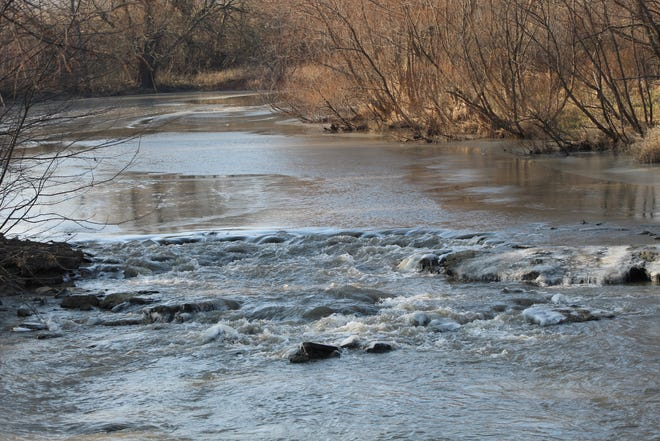 Waters flow through Muddy Creek near the South Main Street bridge in Lindsey. The Sandusky County Park District is hoping to raise enough funds to go along with a $50,000 donation to build a pedestrian or vehicle bridge.