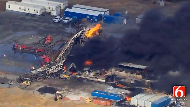 In this Jan. 22, 2018, file photo from video by Tulsa's KOTV/NewsOn6.com, fires burn at an eastern Oklahoma drilling rig near Quinton, Okla. The family of one of five workers who were killed in the explosion says the drilling company didn't act upon multiple warnings that its safety equipment was in disrepair. (Christina Goodvoice/KOTV/NewsOn6.com via AP, File)