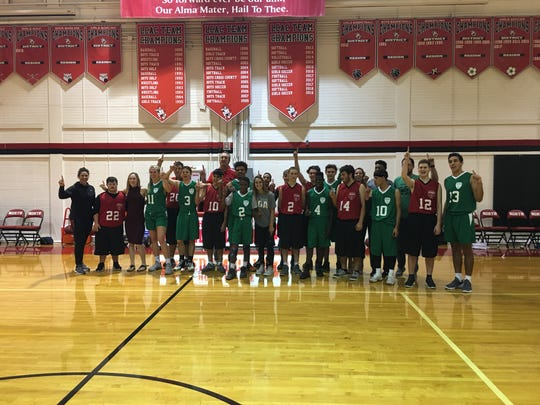 Special Olympics athletes, partners and coaches from Fort Myers and North Fort Myers high schools pose together after a basketball game in Lee County's new Unified Sports program on Friday, Nov. 30, 2018, at North Fort Myers High School.