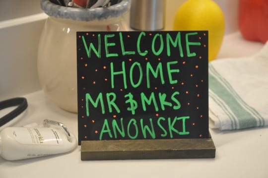 When the Anowskis arrived at their new home, there was a basket of chocolate and fruit, and a welcome sign.