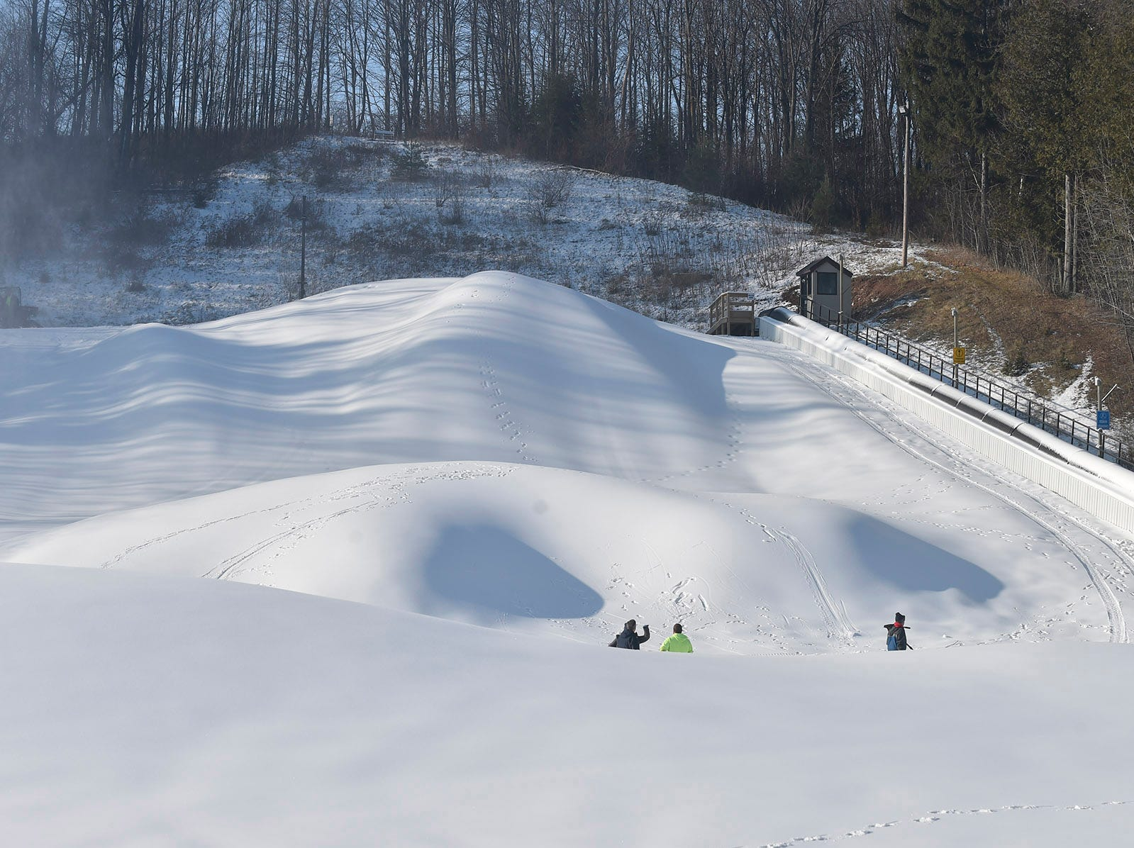 A view looking to the top of the kid-friendly tubing hill at Winter Park. Snow grooming machines will create five lanes for the tubing. At right is the Magic Carpet conveyor lift that was installed last year. Tina M. Gohr/USA TODAY NETWORK-Wisconsin