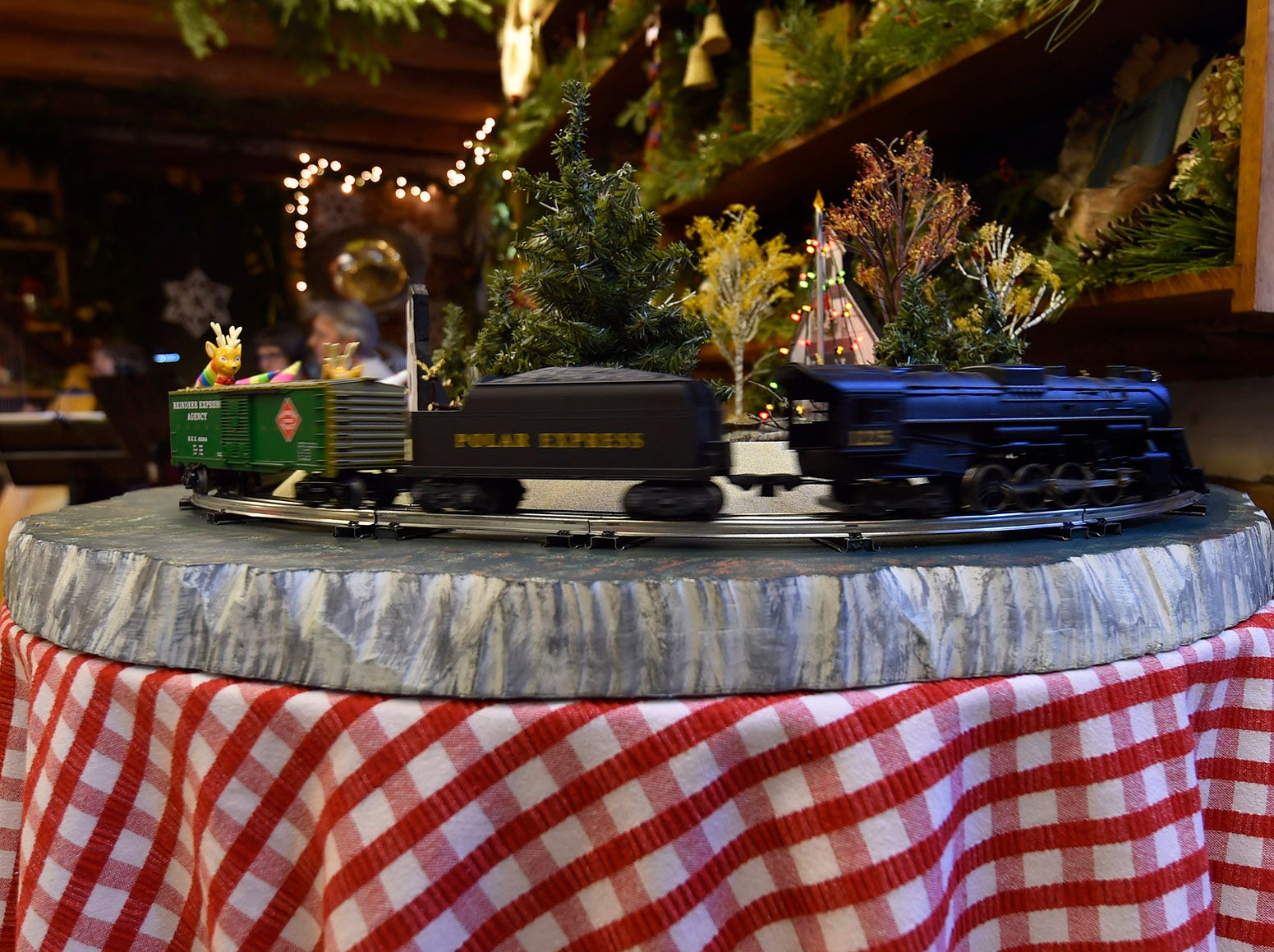 A locomotive in motion inside Kaye Cabin during Natural Christmas at The Ridges Sanctuary, Baileys Harbor, on Saturday, Dec. 8, 2018. Tina M. Gohr/USA TODAY NETWORK-Wisconsin