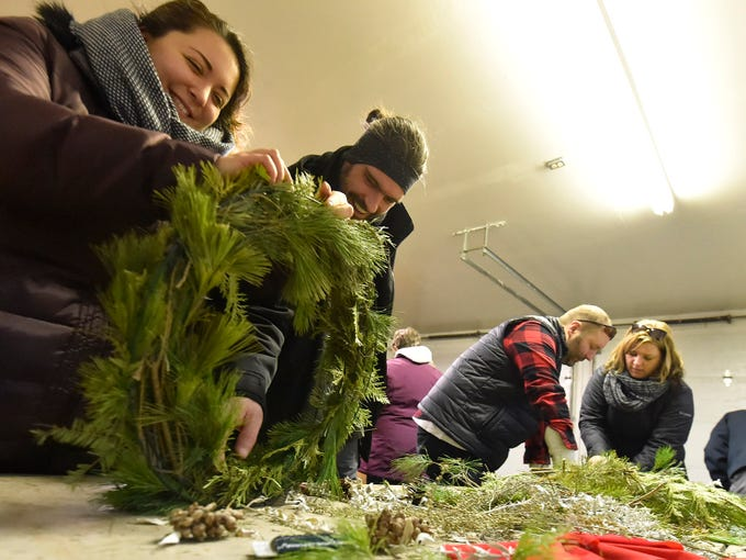 Celia Mokrzycki, left, and Andy Mach, both of Kenosha, create a wreath in a workshop during Natural Christmas on Saturday, Dec. 8, 2018, at The Ridges Sanctuary in Baileys Harbor. More than 100 wreaths were framed and decorated by visitors attending the annual holiday event. Natural Christmas also featured holiday music, roasting chestnuts/marshmallows over an open fire, illuminated trail hikes, Range Lighthouse tours and holiday arts & crafts workshop. Tina M. Gohr/USA TODAY NETWORK-Wisconsin