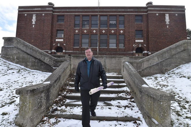 The former West Side School in Sturgeon Bay is a possible site for redevelopment into apartments. Door County Economic Development Corporation Director Jim Schuessler stands on the steps to the building Dec. 12, 2018.
