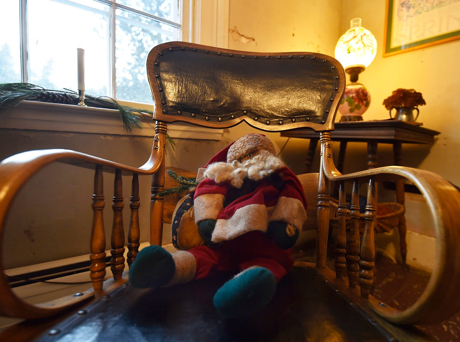 A replica of a vintage Santa sits on a bentwood rocker inside the living quarters of the upper Range Light lighthouse during Natural Christmas at The Ridges Sanctuary, Baileys Harbor, on Saturday, Dec. 8, 2018. Tina M. Gohr/USA TODAY NETWORK-Wisconsin