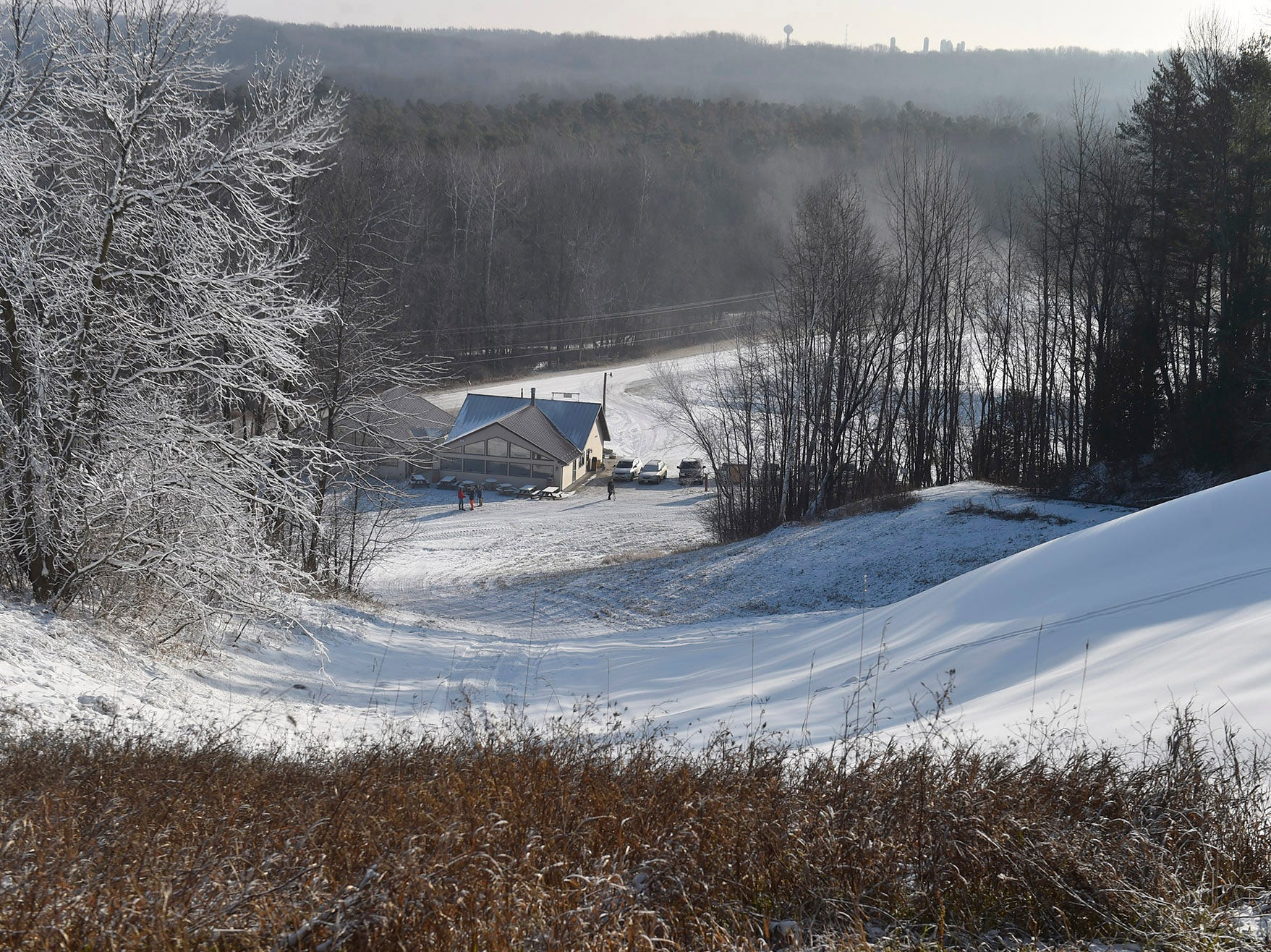 Winter Park in Kewaunee is expected to open Dec. 22 in preparation for another record-breaking season. The park introduces a new beginning or bunny hill ski/snowboarding hill with a handle tow-rope this year. The photo is taken from on top of the advanced ski/snowboard hill with a chalet at the foot of the hill.  Tina M. Gohr/USA TODAY NETWORK-Wisconsin