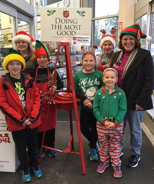 Raymond Paye, left, Bethany Paye, Grant Pieschek, Alanna Paye, Rosalyn Paye, Mikayla Pieschek and Sue Pieschek rang the bells for Salvation Army Dec. 1, 2018, at the Sturgeon Bay Walgreens.