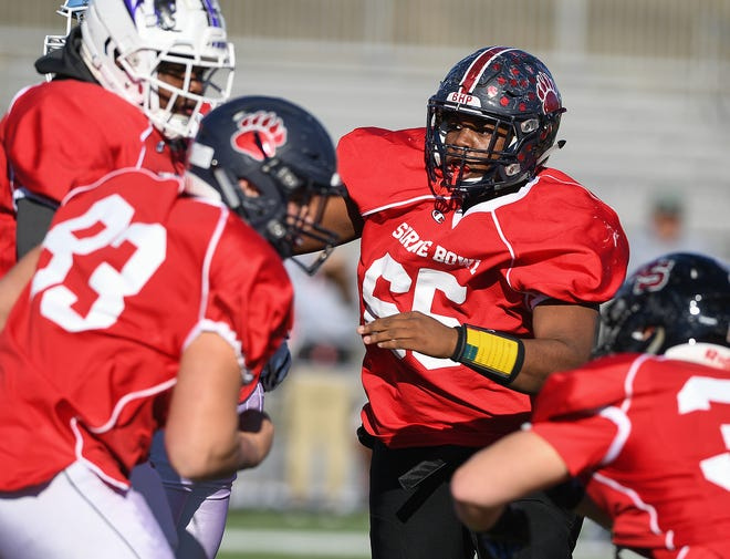 Belton Honea Path defensive lineman Tyshiek Galloway (65) practices with the South Carolina team during Shrine Bowl practice Tuesday, December 11, 2018 at Spartanburg High.
