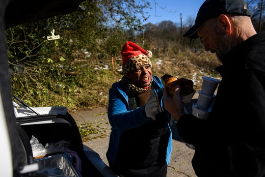 Janice ÒPinkyÓ Whitner gives Michael (last name withheld) homemade chili and bread on Tuesday, Dec. 11, 2018.