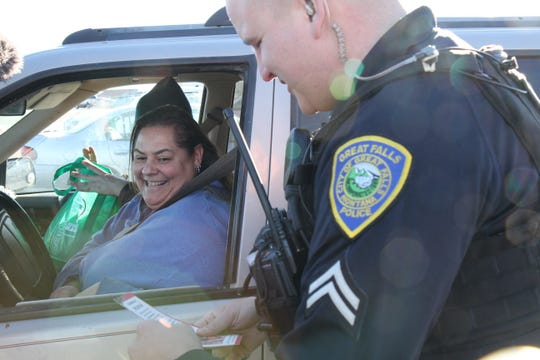 Photos capturing the turkey giveaway in Ashley Marie Shell's memory