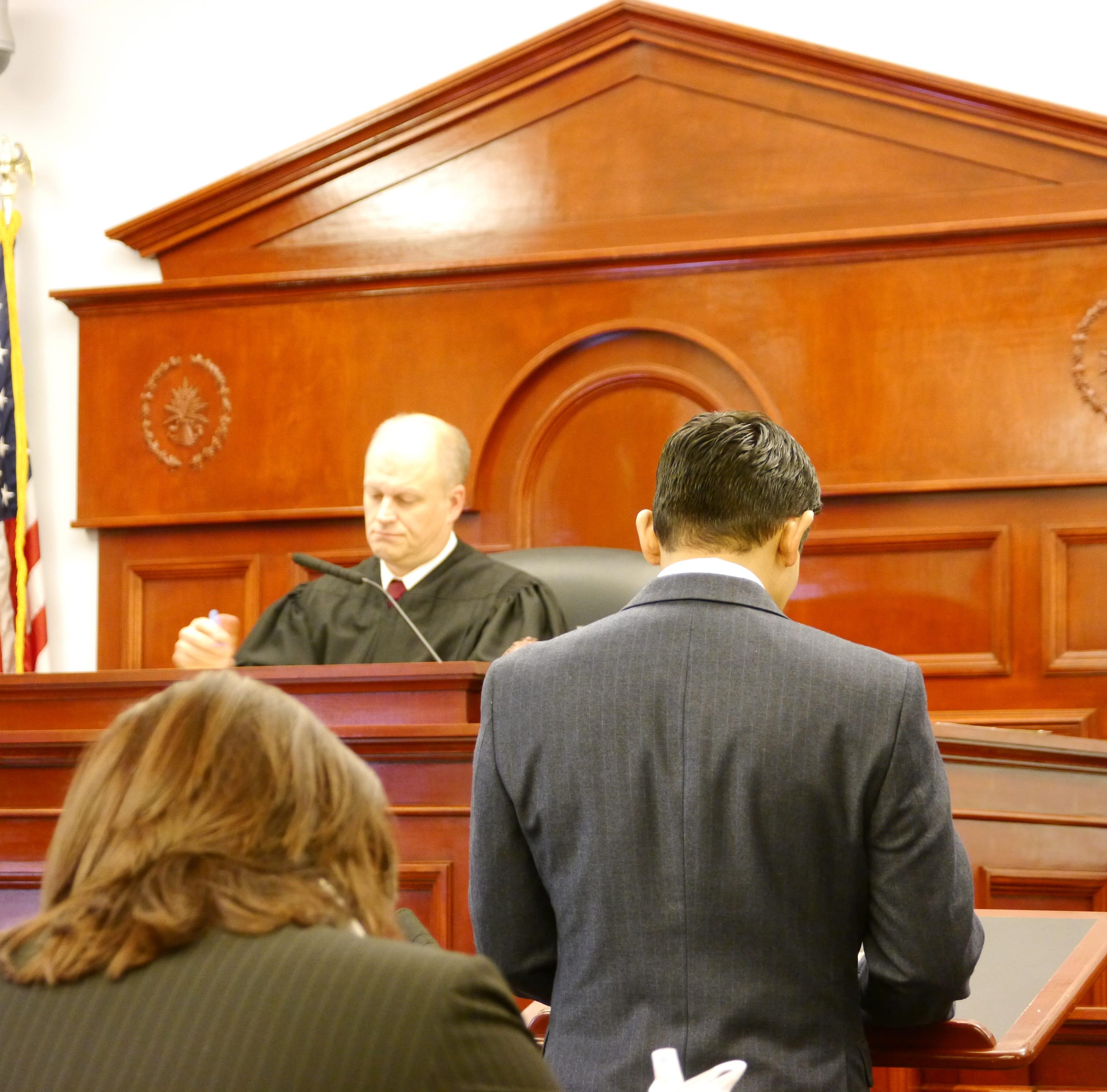 Judge John Parker, left, hears Michael Christian Echeverria's written statement at Monday's sentencing hearing for a 2017 assault case.