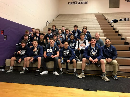 The Great Falls High wrestling team celebrates with the championship trophy after winning the title at last weekend's Mining City Duals in Butte.