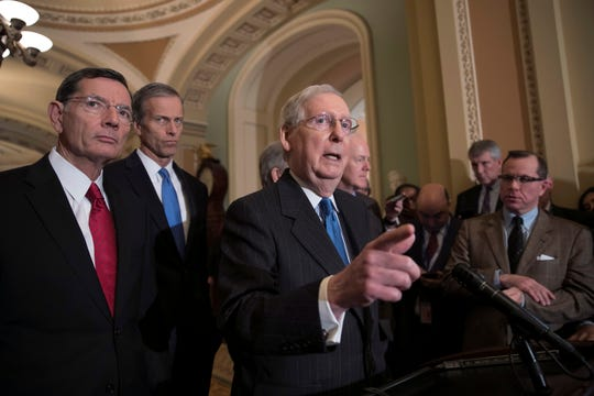 Senate Majority Leader Mitch McConnell, R-Ky., joined from left by Sen. John Barrasso, R-Wyo., and Sen. John Thune, R-S.D., speak following their weekly strategy session Tuesday at the Capitol in Washington,