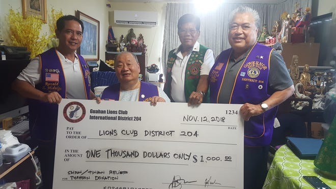 The Guahan Lions Club and Past District Governor Emelio Uy,  presented a $1,000 check to Lions Clubs International, District 204 to support the disaster relief effort.  On Nov.  2, Lions clubs from Saipan distributed $10,000 worth of food items from funds received from Lions Club International Foundation. Guam Lions Clubs donated an additional $10,000. Shown from left:  Ron Hidalgo, District 204 treasurer;  PDG Uy;  Romy Arias, Guahan LC first vice president and Danny Cruz, district governor.