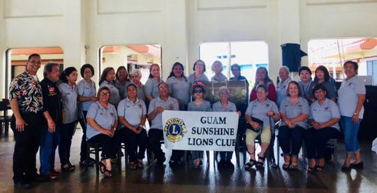 "The Guam Sunshine Lions Club, LCI District 204, held its annual raffle fundraiser drawing on November 17 at the Chamorro Village. Proceeds will benefit recipients of the club's ""Caring for the Sick and the Elderly"" service project, as well as other projects related to Vision, Environment, Hunger Relief, Disaster Relief, Childhood Cancer, and Diabetes. Seated from left: Lions Jill Pangelinan, Tish Tano, Pete Blaz, Sid Weedin, Jovie Mejorada, Loling Blaz, Julie Cruz, and Mary Taitano. Standing from left: Lions Frank Aguon, Jr., Johnny Villagomez (Guam Tano Ta Branch Club), Linda Villagomez, Sera Taitano, Clarice Quichocho, Jojo Pillsbury, Helen Mendiola, Laling Camacho, Lorraine Rivera, Doris Limtiaco, Lola Flores, Josephine Borja, LouJean Borja, Helen Colby, Cindy Mendiola, Julie LeBreton, and Dee Cruz."