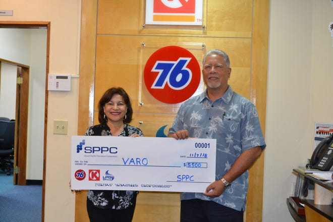 South Pacific Petroleum Corporation presented a check for $5,500 to VARO (Victim Advocates Reaching Out) on Nov. 7. The proceeds were raised from SPPC's Drive for Charity Golf Tournament. Pictured from left: Dr. Judith T. Won Pat – VARO president and Mark J. Sablan SPPC's VP Business Development.