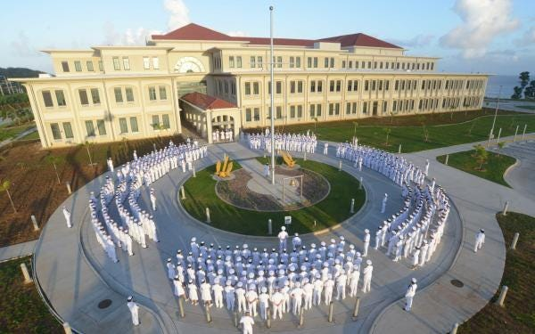 In this Nov. 2015 photo, sailors from U.S. Naval Hospital Guam prepare for their annual dress whites inspection.