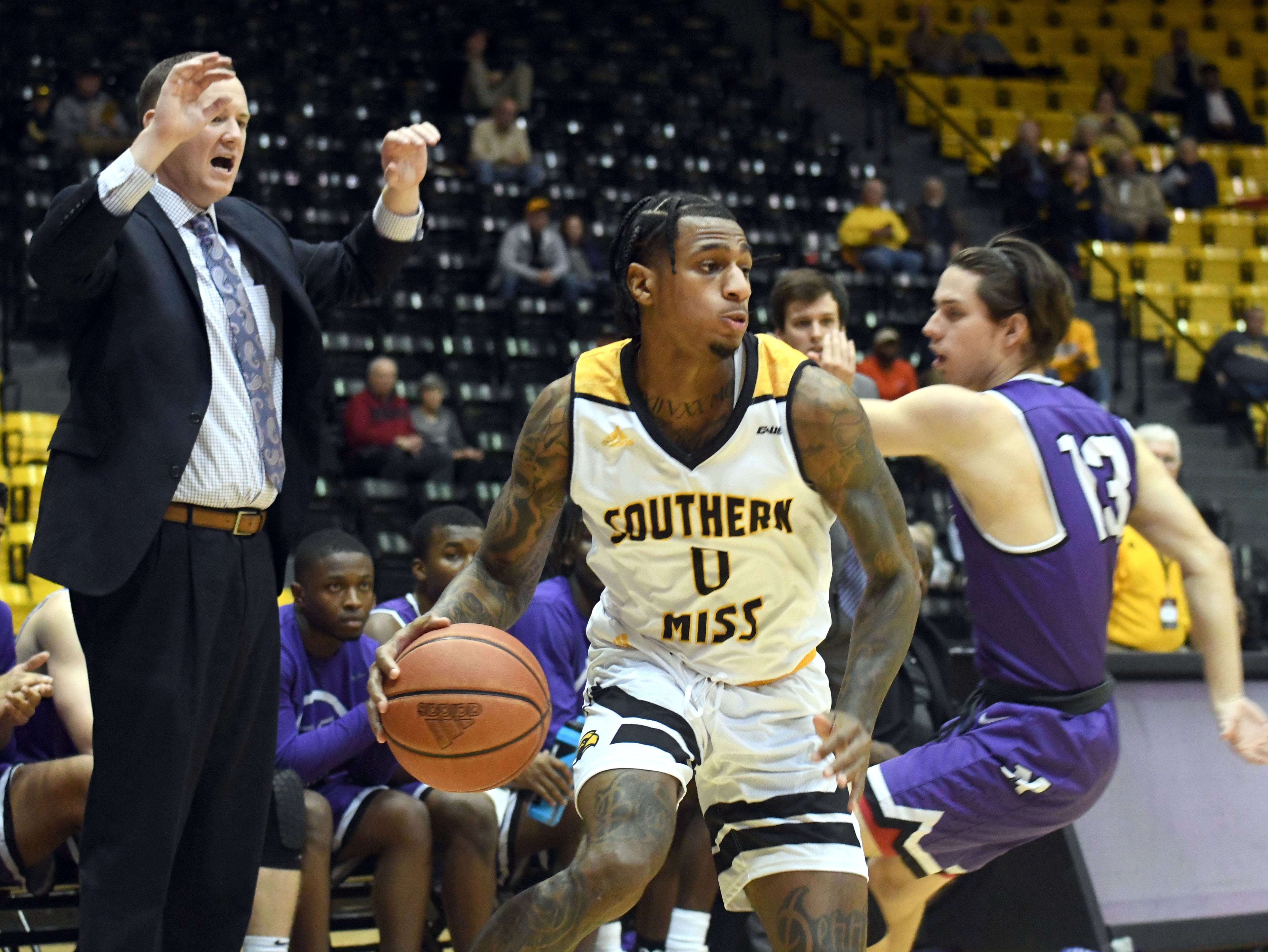 Southern Miss guard Dominic Magee takes control of the ball in a game against Millsaps in Reed Green Coliseum on Tuesday, December 11, 2018.