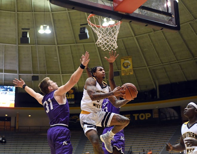 Southern Miss guard Dominic Magee shoots for the basket in a game against Millsaps in Reed Green Coliseum on Tuesday, December 11, 2018.