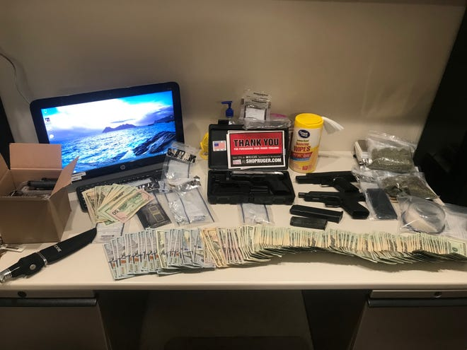 Weapons, drugs, cash, and more found in the vehicle of the suspect.