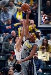 Pacers center Myles Turner blocks a shot by Bulls guard Zach LaVine.