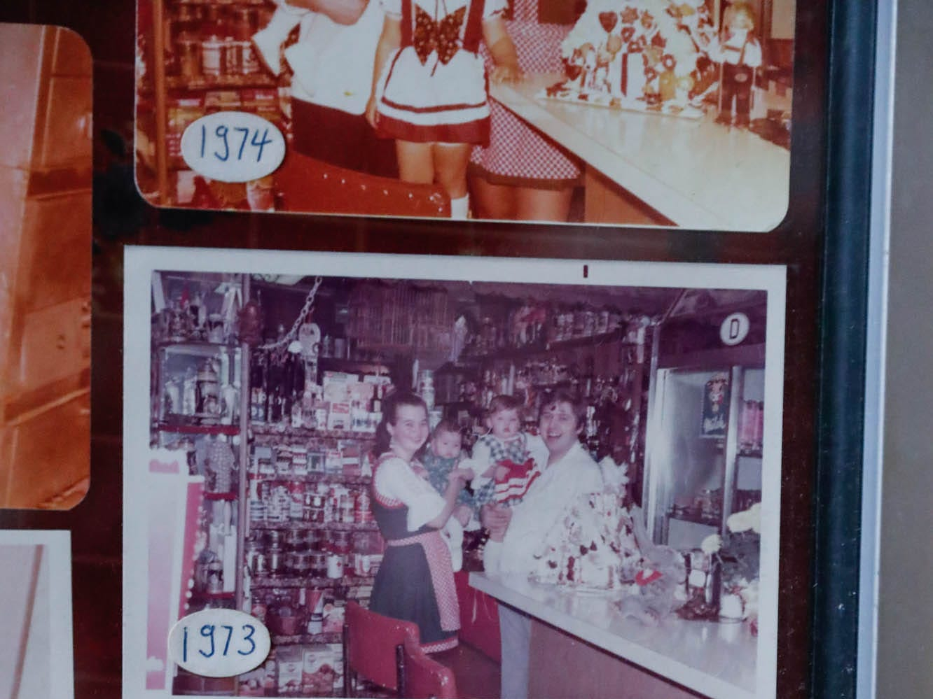 "Photos of Heidelberg Haus Cafe and Bakery owners Juergen ""JJ"" Jungbauer and his family standing in the same place in the cafe every year are posted on the wall on Saturday, Dec. 8th, 2018."