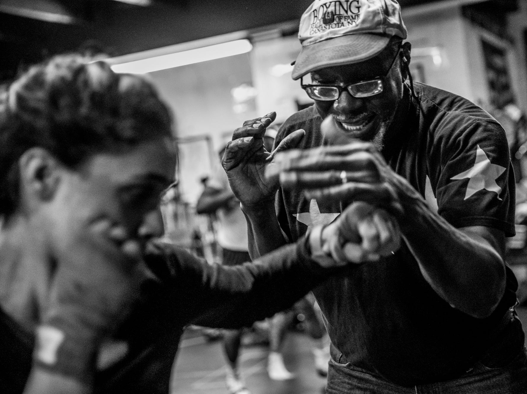 """Bring it before you shoot it,"" said Sugar Ray Seales, while training boxing students on Monday, March 26, 2018. ""Way to work, way to work, way to work. That's right. Nice jab, now come get it. Step on it. That's that jab. That's that jab. Good."""