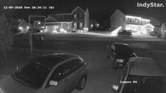 A black SUV drives up onto the front yard of Daniel and Casie Arnold's Greenwood home