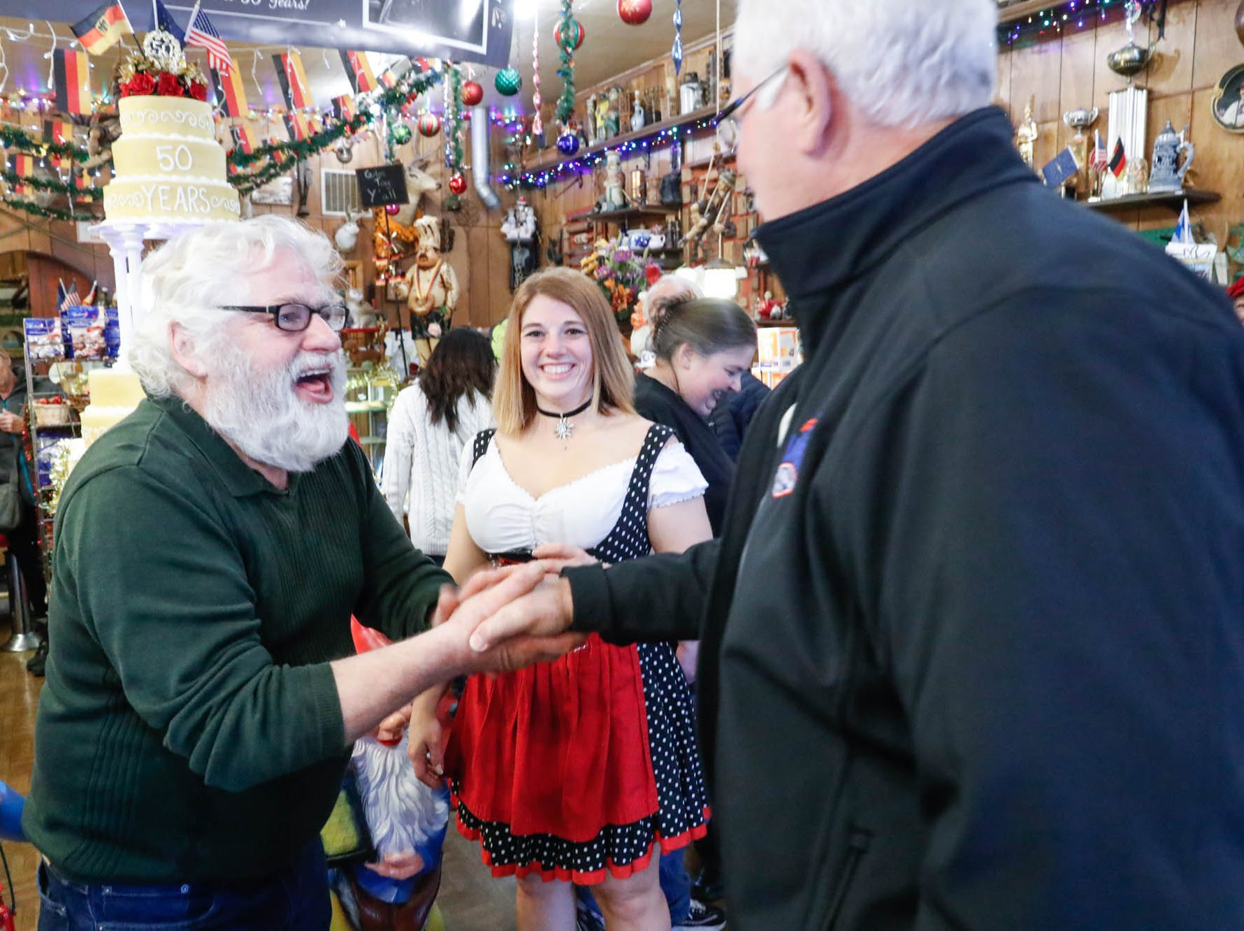 "Heidelberg Haus Cafe and Bakery owner Juergen ""JJ"" Jungbauer greets Lawrence Mayor Steve Collier during a party celebrating the cafe 50th year in business, on Saturday, Dec. 8th, 2018. The cafe, bakery, and German grocery is well known for its extensive collection of German Kitsch."